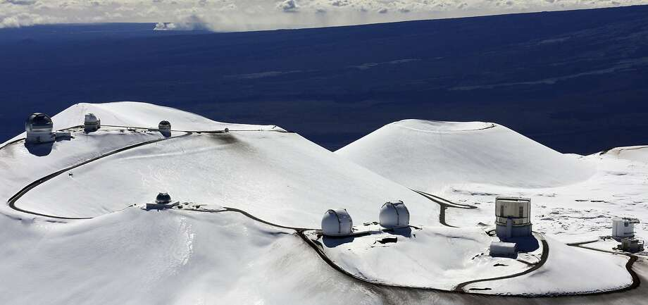 Observatories are seen in the winter of 2009 on the peak of Mauna Kea on Hawaii's Big Island where some demonstrators have been protesting the construction of a new telescope. Photo: Tim Wright / Associated Press 2009