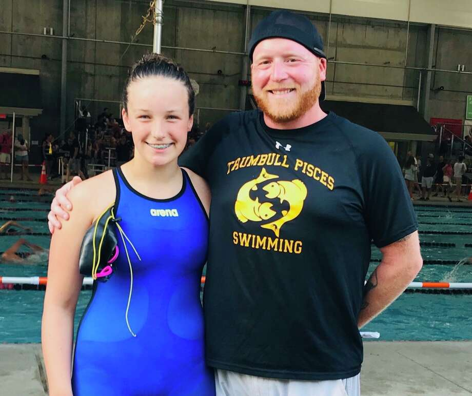 Kristen Racicot with Pisces head coach Bill Strickland at CT Age Group Championships. Photo: Contributed Photo / Trumbill Pisces / Trumbull Times