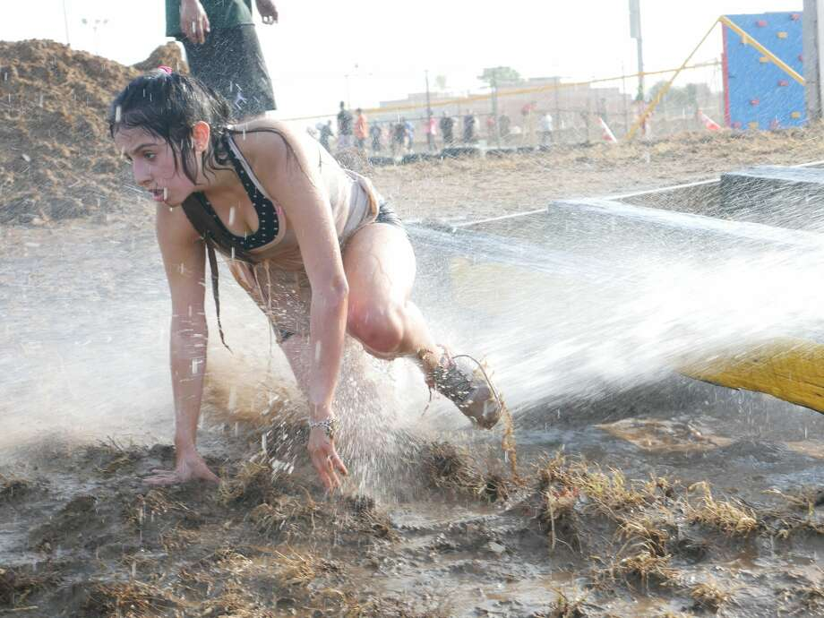 Laredo locals pose for pictures and participate in the first Bull-Run Biathlon & Dry/Mud Obstacle Course at Freddy Benavides Park. Photo: Cuate Santos/Laredo Morning Times