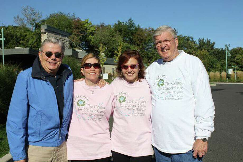 "The Annual 5K Walk/Run to benefit the Center for Cancer Care at Griffin Hospital will present the first William C. Powanda Memorial Award to the top individual fundraiser this year. Pictured left to right, John ""Jack"" Betkoski III, past Chairman of the Board of Directors for Griffin Hospital, 5K Co-chairs Lori Murphy and Laura Murphy, and Powanda. Photo: Contributed / Griffin Hospital"