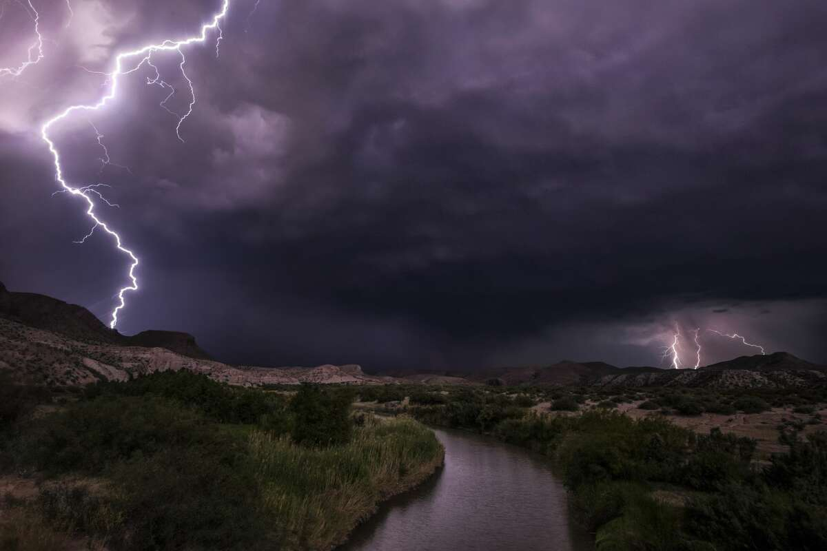 Lightning is seen on either side of the United State-Mexico border on June 24, 2017.