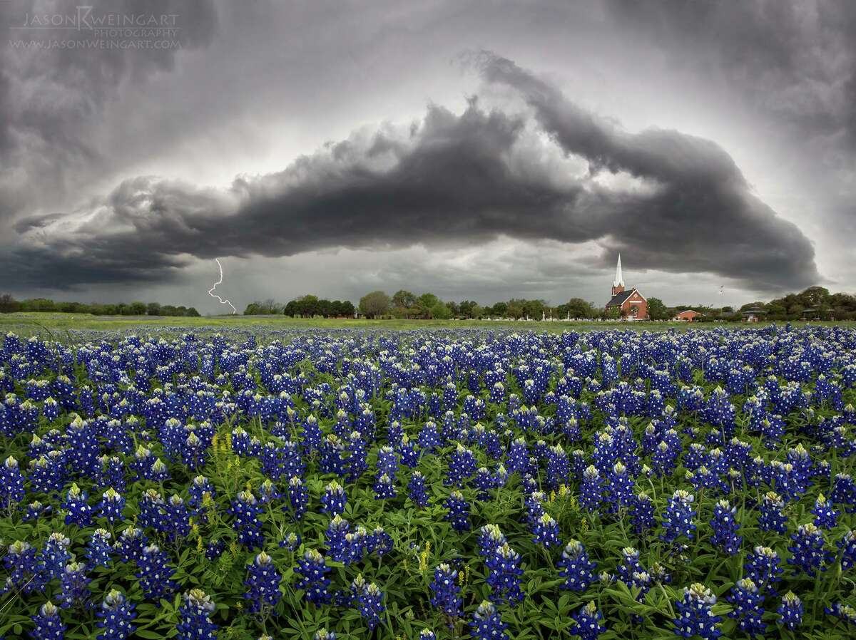 Storm brewing over bluebonnets, Round Rock, Texas, in April 2014. >> Keep clicking through the gallery to see more of Jason Weingart's incredible storm photos from across Texas.