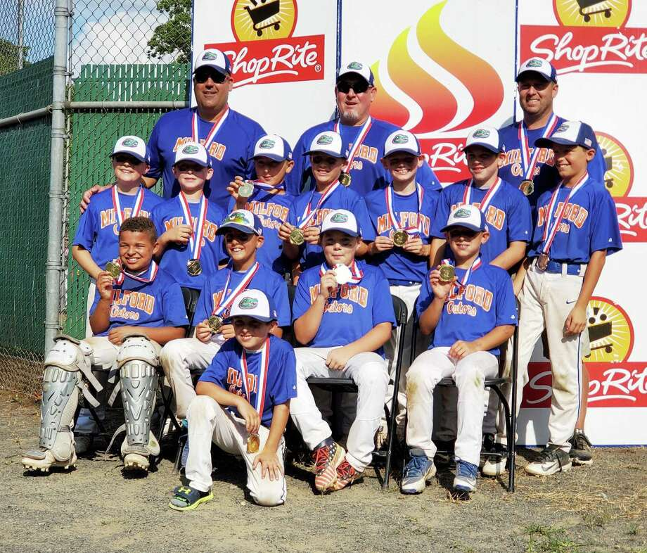 Leading the Milford Gators to gold were (front row) Pauly Martin; (second row) Matt Martin, Nick Idone, Kyle Daniels and Kevin Cepetelli; (third row) Tyler McTigue, Logan Thomas, Kenny Esposito, Owen Trice, Peyton Pettey, Jack Marschner and Danny Asermely; and (fourth row) coaches Anthony Idone, Dan Martin and Andy Trice. Photo: Contributed Photo / Milford Little League / Milford Mirror