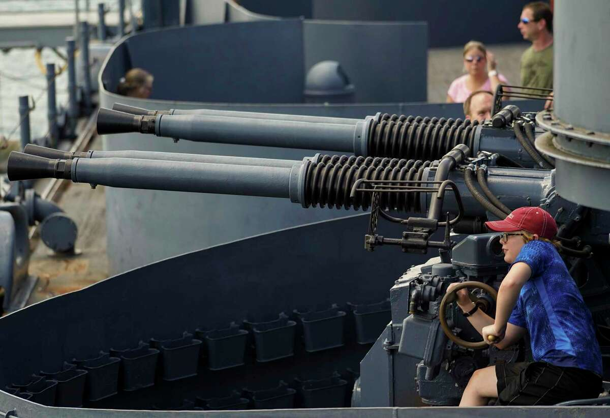 People visiting Battleship Texas, which served both World War I and World War II, can see the five-inch, three-inch, and 40 millimeter guns that are part of the ship Sunday, Aug. 11, 2019, in Houston. The ship will be closing to visitors Aug. 25. The Battleship Texas Foundation will be taking over the operations and repairs of the 106-year-old ship. The nonprofit organization will be moving the ship for repairs and will find it a longtime home.