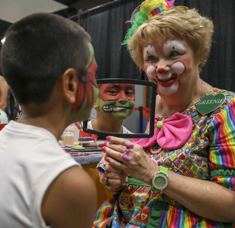 Greenie the Clown, Linda Greene, shows David Montez III his Mutant Ninja Turtle face paint during the Family Fun Day on Saturday, Aug. 10, 2019 at the Horseshoe Pavilion. Photo: Jacy Lewis/191 News