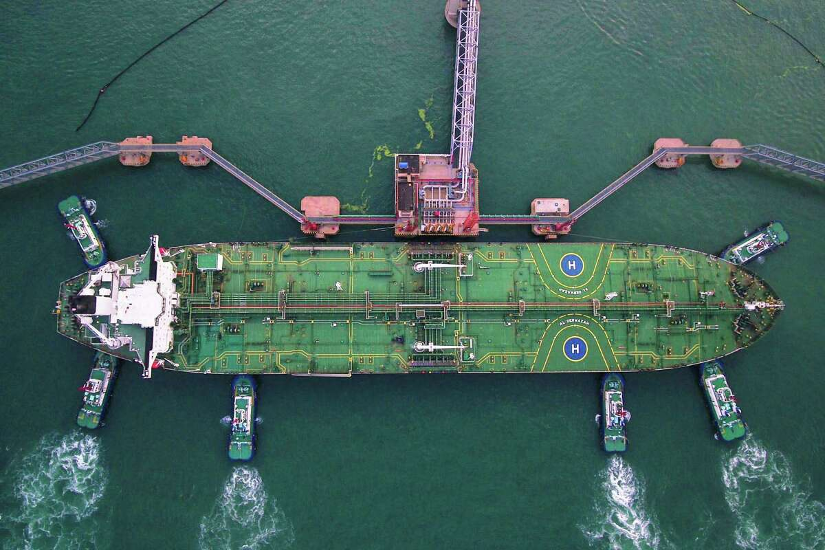 Tugboats berthing an oil tanker at Qingdao port in Qingdao in China's eastern Shandong province. China could target U.S. crude in its next round of retaliatory tariffs, analysts say.