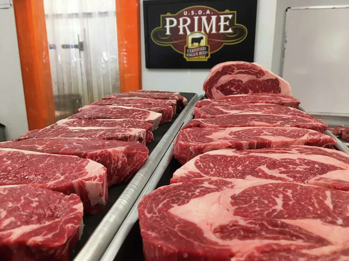 A tray of Akaushi beef at Tri-County Meat Market at 13215 Huebner Road includes rib-eyes and New York strip steaks.