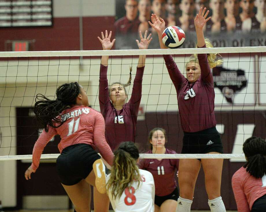 Haley Payne (15) and Madalyn O'Brien (20) of Cinco Ranch block a shot delivered by Jasmine Walker (11) of Cy Lakes during the first set of a volleyball match between the Cinco Ranch Cougars and the Cy Lakes Spartans on Friday, August 9, 2019 at Cinco Ranch HS, Katy, TX. Photo: Craig Moseley, Staff / Staff Photographer / ©2019 Houston Chronicle