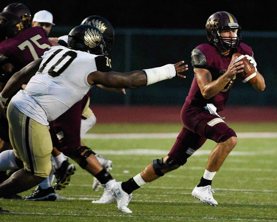 Magnolia West quarterback Jon Matocha, right, avoids the tackle of Foster defensive lineman Chidozie Nwankwo during the first half of a high school football game, Friday, Sept. 14, 2018, in Magnolia, TX. (Eric Christian Smith/Contributor) Photo: Eric Christian Smith, Contributor / Contributor