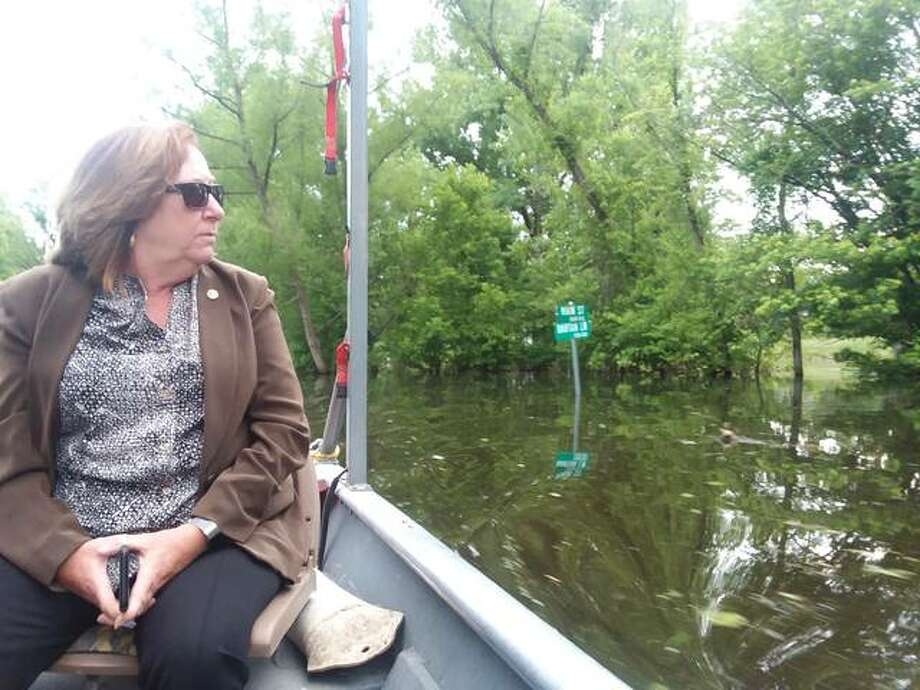 State Rep. Monica Bristow, D-Alton, tours flooding in the Jersey County village of Elsah along Illinois 100. Flood damage assessment teams on Monday began a statewide review of flood-related damages and costs in preparation for Gov. J.B. Pritzker's federal assistance request due Sept. 3.