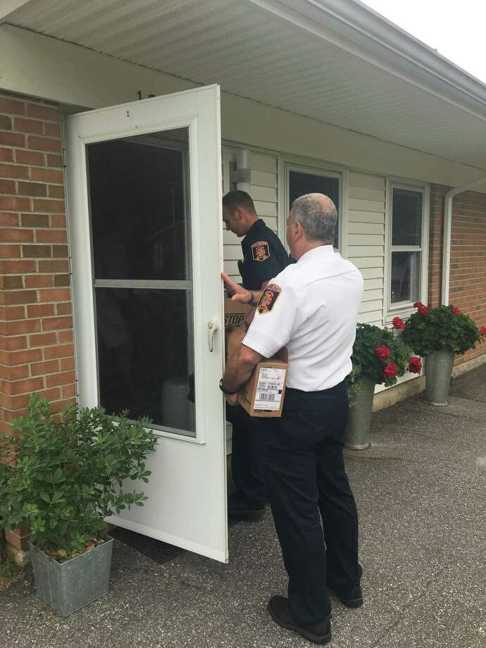 On August 7, the Torrington Fire Marshal's Office, members of the Torrington Fire Department, and the Torrington Housing Authority installed stove top extinguishers in each unit (56) including the Community Room at Laurel Acres. Photo: Contributed Photo /