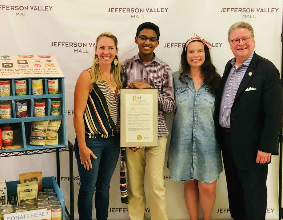 From left, Jefferson Valley Mall marketing director Heather Novak, Navod Jayawardhane, mall general manager Alexa O'Rourke, and New York state Sen. Pete Harckham celebrate the installation of Navod's electronic food box at the mall on Aug. 6. Photo: Contributed Photo / / Wilton Bulletin Contributed