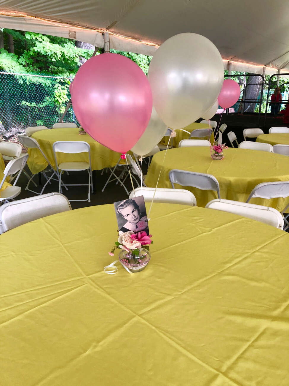 Balloons and photos to honor the late Marylou Whitney adorned the tent on the first Sunday night dinner this year at the backstretch.