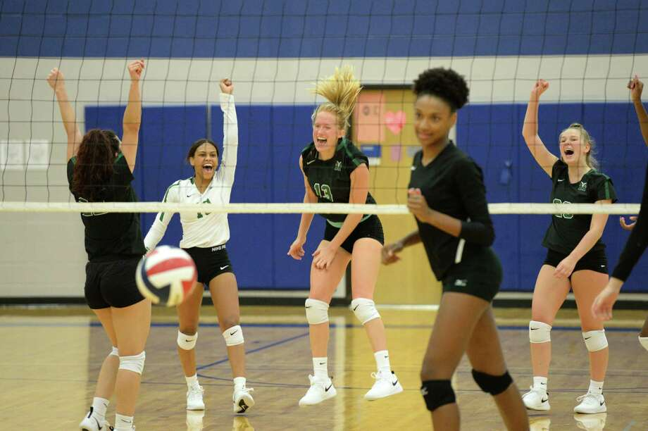The Mayde Creek Rams celebrate a point during the second set of a volleyball match against the Ft Bend Austin Bulldogs on Thursday, August 8, 2019 at Taylor HS, Katy, TX. Photo: Craig Moseley, Staff / Staff Photographer / ©2018 Houston Chronicle