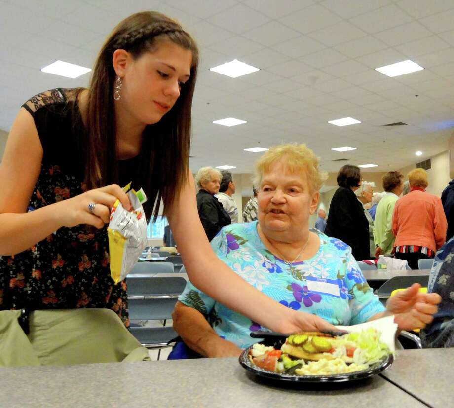 In a file photo, Karalyn Meineke serves Carole Madgie of Derby Senior Center her meal. Photo: File