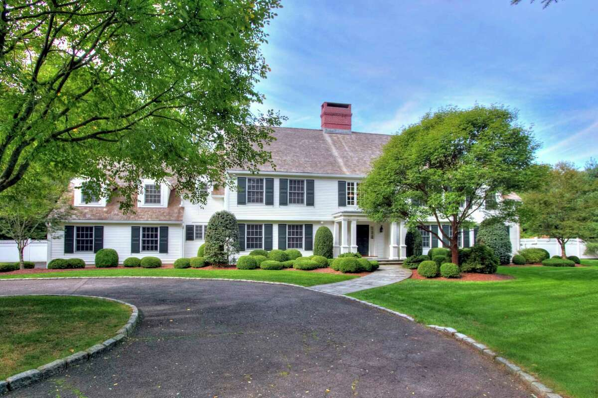 The white clapboard colonial at 1901 Fence Row Drive was built in the exclusive gated community called The Ridge in 1989 and more recently was remodeled by award-winning local architect Jack Franzen and renowned builder Keith Manca.