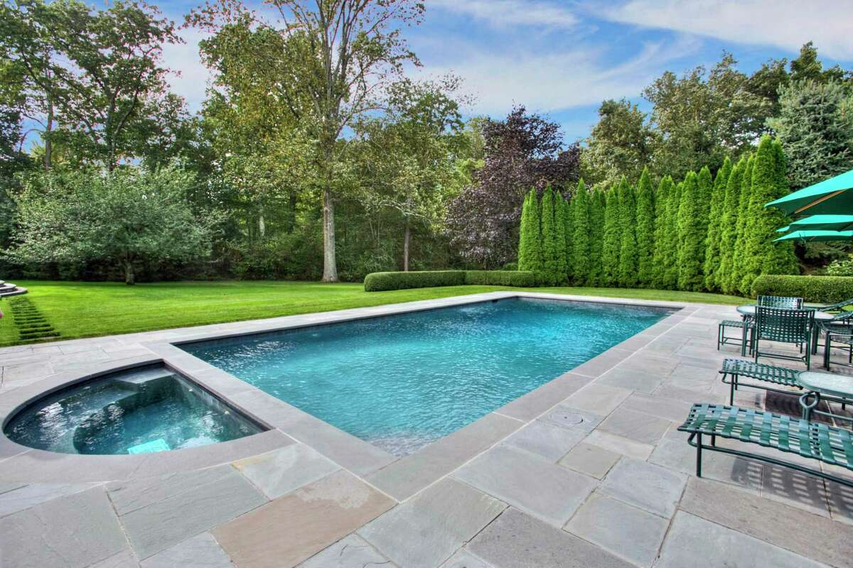 Although residents of The Ridge have use of the private enclave's own country club amenities including an in-ground swimming pool and tennis courts, this house enjoys its own pool and spa on its 2.23-acre property.