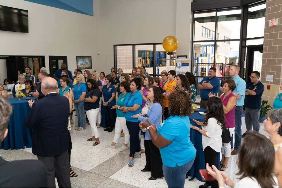 Pearland city and business officials and staff members attend a recent ribbon-cutting ceremony for the renovated St. Helen Educational Building, which houses St. Helen Catholic School. Photo: Nick Pomes Photo