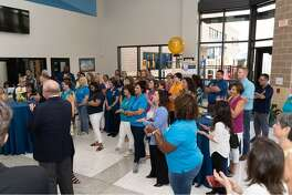 Pearland city and business officials and staff members attend a recent ribbon-cutting ceremony for the renovated St. Helen Educational Building, which houses St. Helen Catholic School.