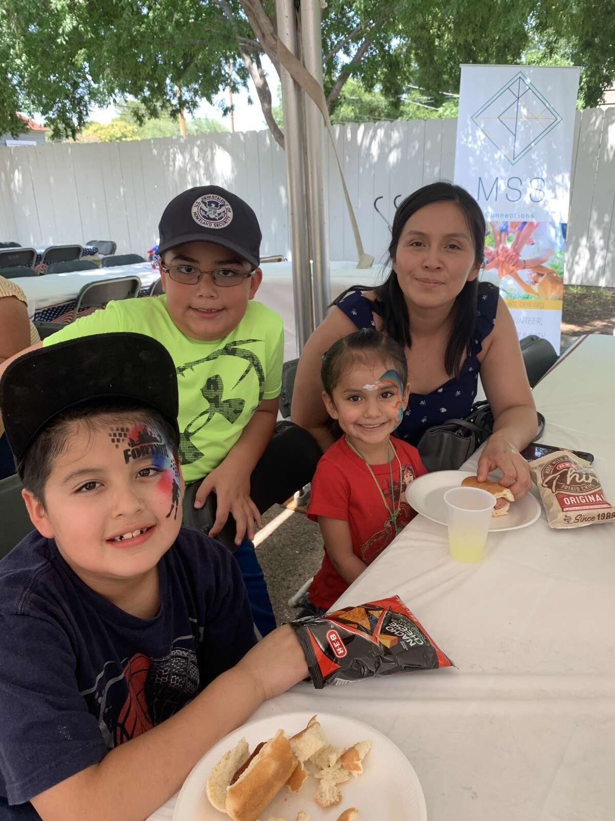 Bush bash:John Corral, from left, Carlos Casarez, Lily Corral and Sandra Corral