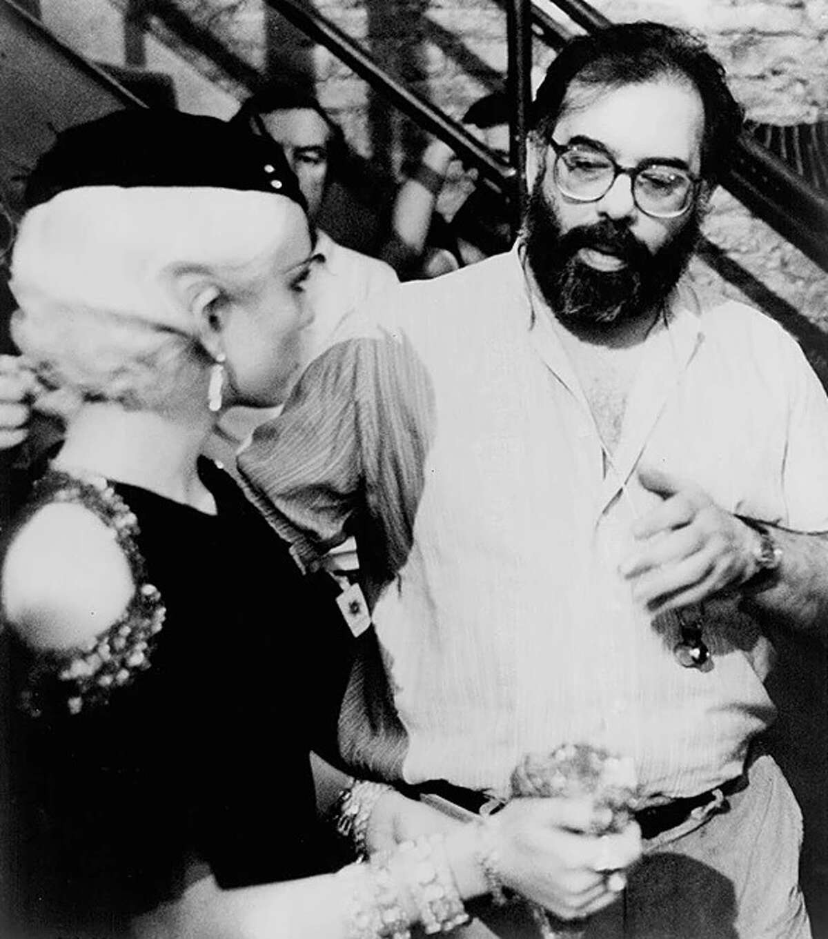 """Actor Diane Lane and director Francis Ford Coppola discuss a scene during filming of """"The Cotton Club."""""""