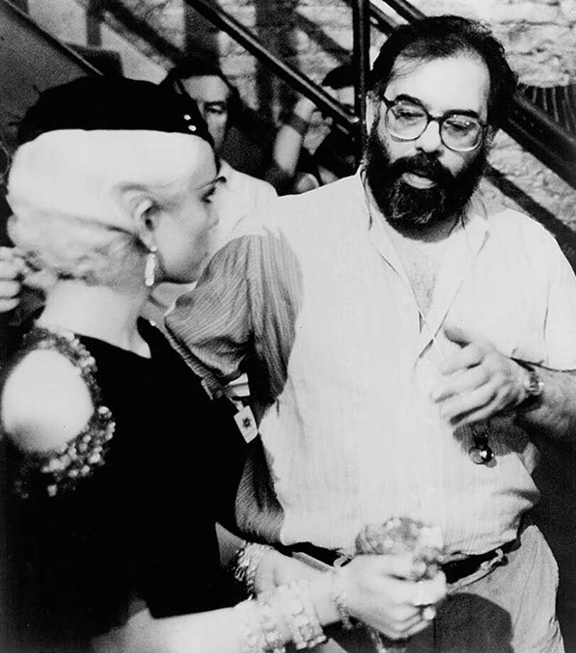 """Actor Diane Lane and director Francis Ford Coppola discuss a scene during filming of """"The Cotton Club."""" Photo: Courtesy NYS Writers Institute"""