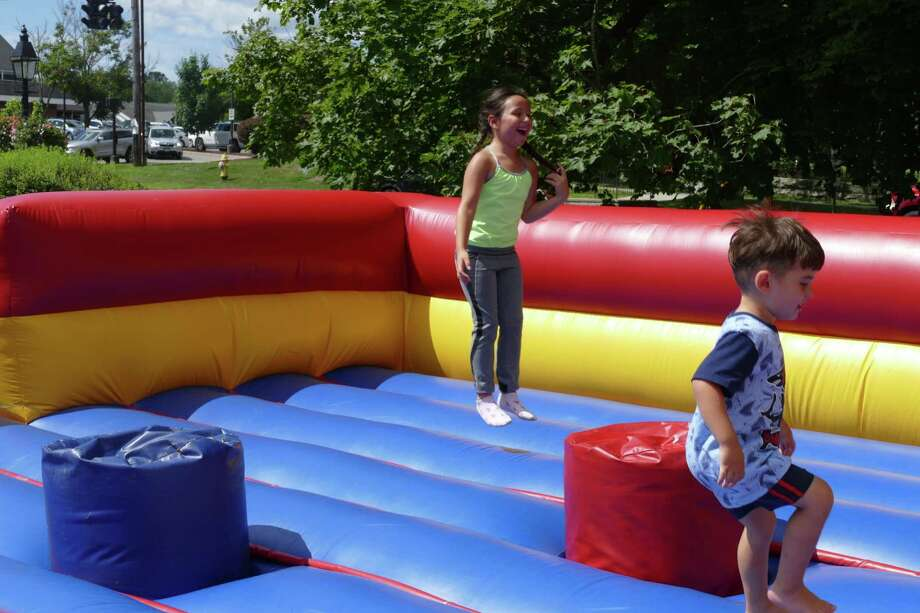 Kids bounce around in the inflatable course at the fifth annual RidgeCon on Saturday, Aug. 10. Photo: Stephen Coulter / Hearst