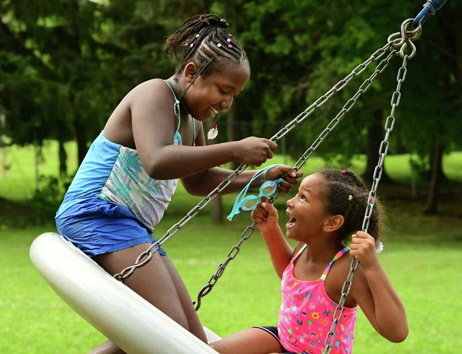 Shazziaha Murray, 9, of Albany enjoys the thrill of a tire swing with Crai'lynn Jean-Gilles, 7, of Albany in between swims at the Lincoln Park Pool on Monday, Aug. 12, 2019 in Albany, N.Y. (Lori Van Buren/Times Union) Photo: Lori Van Buren, Albany Times Union