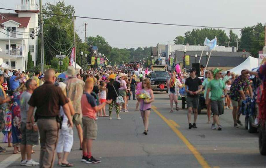 The Parade of Tropical Fools always brings a large crowd to downtown Caseville, as seen in this image. The parade is scheduled to begin at 5:30 p.m. Wednesday. (Tribune File Photo)