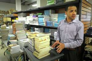 Manager Richard Hebert speaks in the of the University of Bridgeport bookstore, in Bridgeport, Conn. Aug. 12, 2019. The university is launching a program that will allow all students to borrow print and electronic textbooks books for all courses they sign up for each semester.