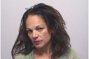 Marilyn Ecay, 55, of Cove Road, was charged Sunday with stabbing her boyfriend with a machete.