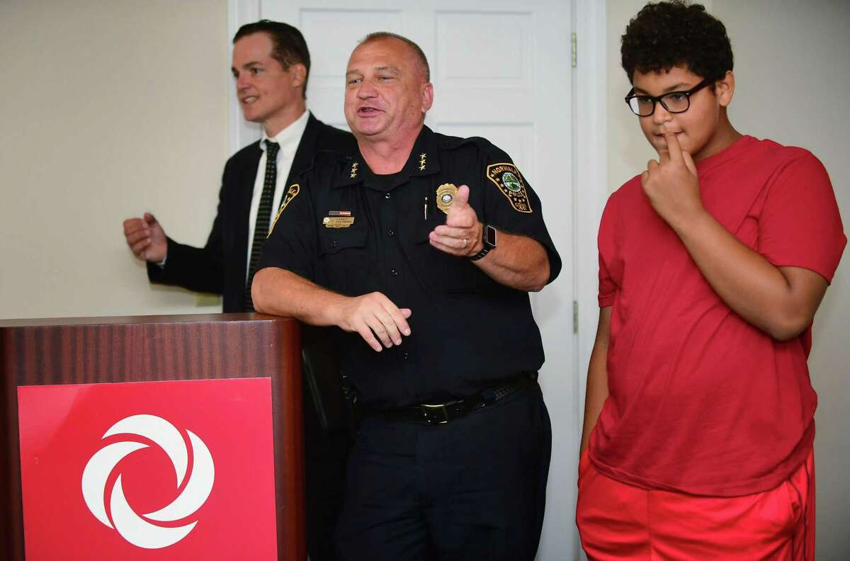 The Human Services Council Executive Director Anthony DiLauro holds a press conference featuring Norwalk Police Chief Thomas Kulhawik and his mentee Joshua Legere, 13, in an effort to raise awareness of the Norwalk Mentor Program and recruit at least 100 new mentors Wednesday, August 7, 2019, at their offices lat One Park Street in Norwalk, Conn. The event showcased some of the HSC mentor/mentee success stories and offer attendees the opportunity to help grow the Norwalk Mentor Program and provide more Norwalk students with an adult mentor.