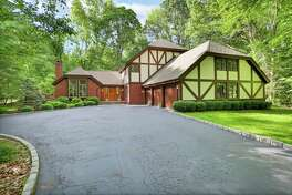 The Tudor-style house at 175 Twin Lanes Road sits at the end of a cul-de-sac in Easton near the Fairfield town line.