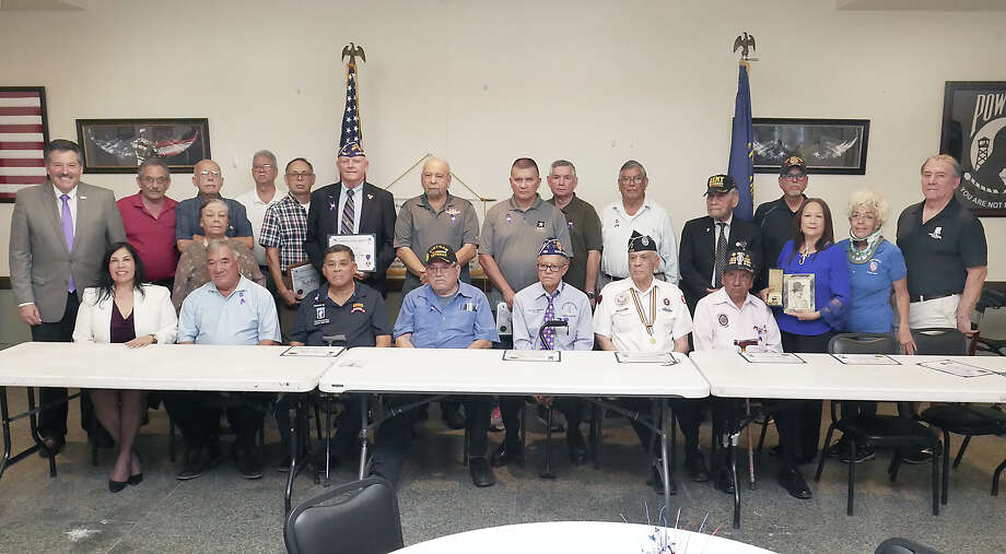 Mayor Pete Saenz and members of LULAC Veterans Council 777 pose with local military veterans and family members, of veterans who have passed, who have received of the Purple Heart Medal, were honored by the council during a Purple Heart Day Recognition Ceremony Wednesday, August 7, 2019, at the Arturo T. Benavides Post 59 American Legion. Photo: Cuate Santos/Laredo Morning Times
