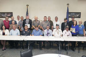 Mayor Pete Saenz and members of LULAC Veterans Council 777 pose with local military veterans and family members, of veterans who have passed, who have received of the Purple Heart Medal, were honored by the council during a Purple Heart Day Recognition Ceremony Wednesday, August 7, 2019, at the Arturo T. Benavides Post 59 American Legion.