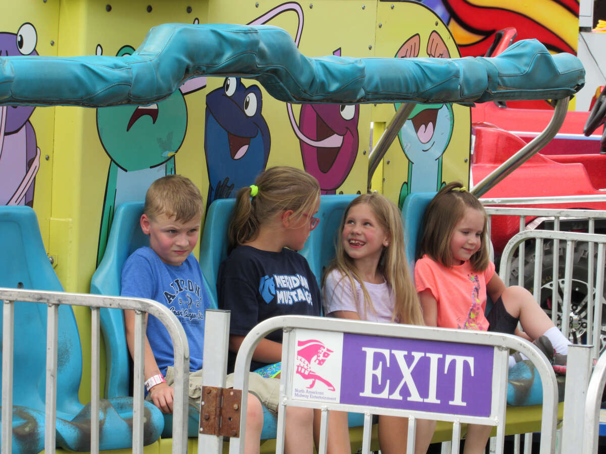 Midland residents flock to the Midland County Fair on Monday to enjoy rides, attractions, food and more on Aug. 12, 2019. (Mitchell Kukulka/Mitchell.Kukulka@mdn.net).