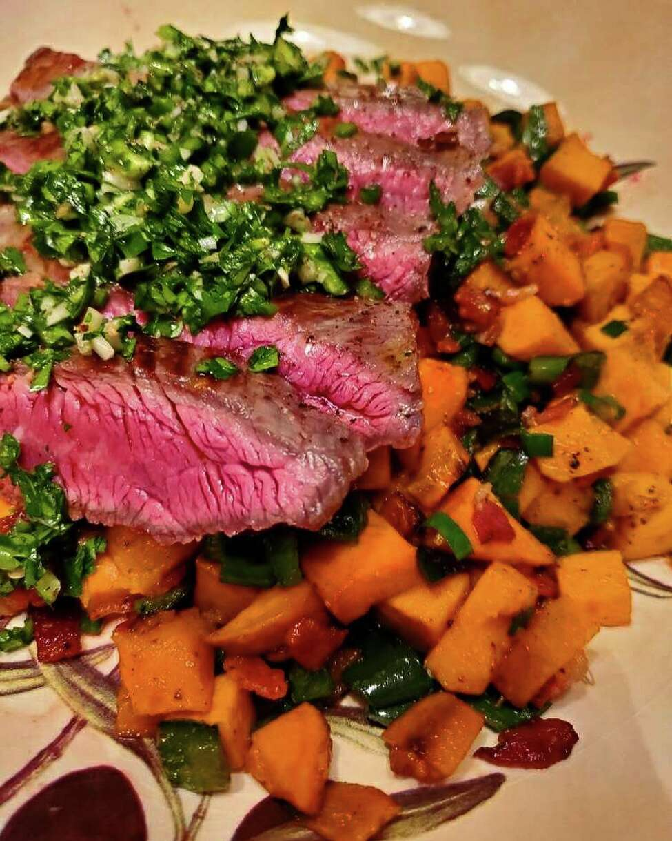 Grilled flank steak with chimichurri and poblano sweet potato hash from The Bishop in Albany, N.Y.