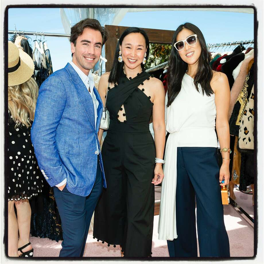 Dr. Carolyn Chang (center) strikes a pose with Oscar de la Renta co-designers Fernando Garcia and Laura Kim. Aug. 3, 2019. Photo: Drew Altizer / Drew Altizer Photography