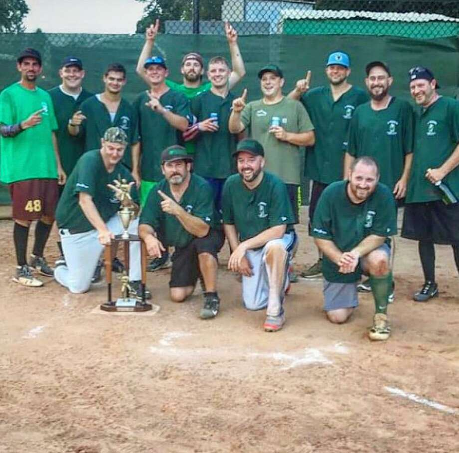 The Mulvaney Plumbing/Rossini Landscaping team after winning the Ridgefield Men's Softball League championship. Top row (left to right): Danny Coakley, Tommy Shaw, Rob Malara, Mike Sommerer, Tim Cozens, Danny Lake, Jeff Lavatori, Pete Rossini, Adam Kilcran, Anthony Tucker; bottom row: AT Walker, Brian Gray, Matt Leonard, Tim Aiezza. Not shown: Adam Lanehart, Jordan Guerrero, Pat Molyneaux, Charlie Coakley. Photo: Ridgefield Men's Softball / Contributed Photo