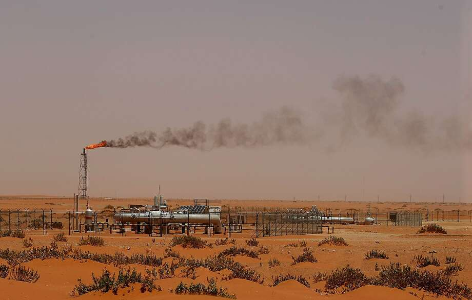 "(FILES) In this file photo taken on June 23, 2008, a flame from a Saudi Aramco oil installion known as ""Pump 3"" is seen in the desert near the oil-rich area of Khurais, 160 kms east of the Saudi capital Riyadh. Photo: Marwan Naamani, AFP/Getty Images"