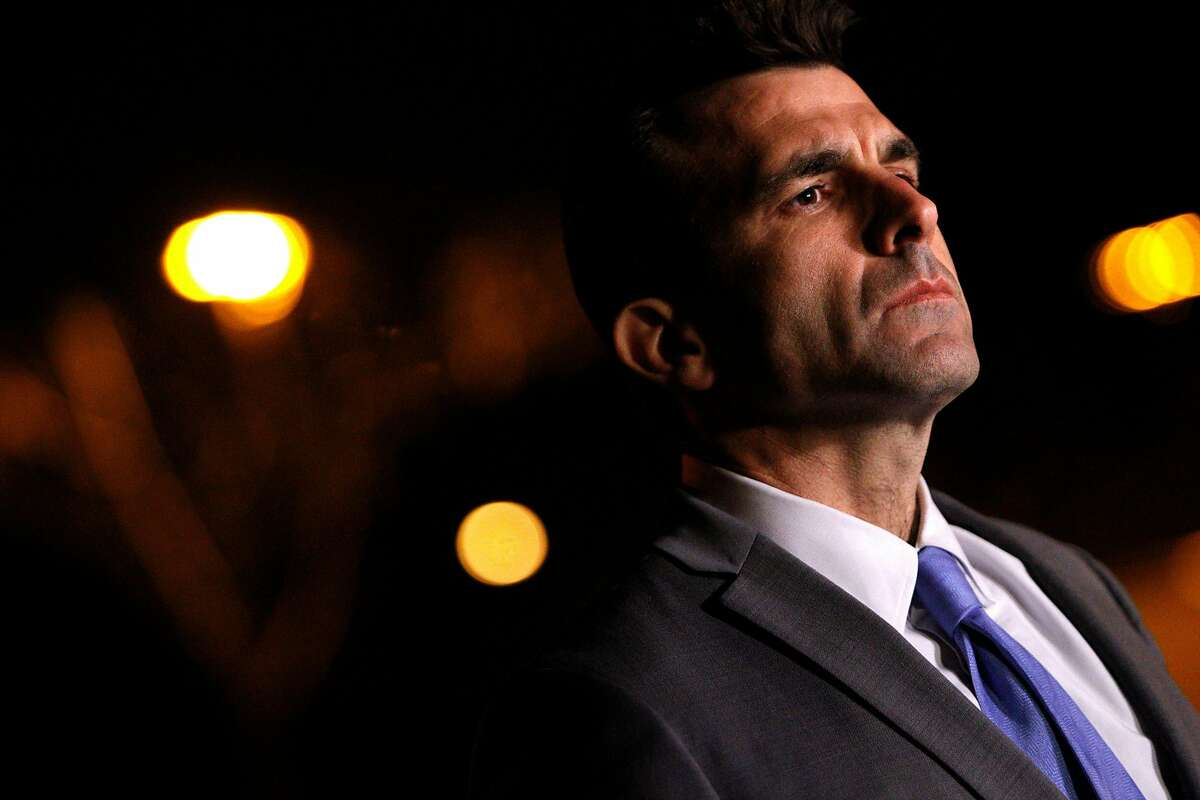San Jose Mayor Sam Liccardo listens in to San Jose police chief Larry Esquivel during a press conference following the shooting death of a San Jose police officer earlier today, Tuesday, March 24, 2015, in San Jose, Calif.