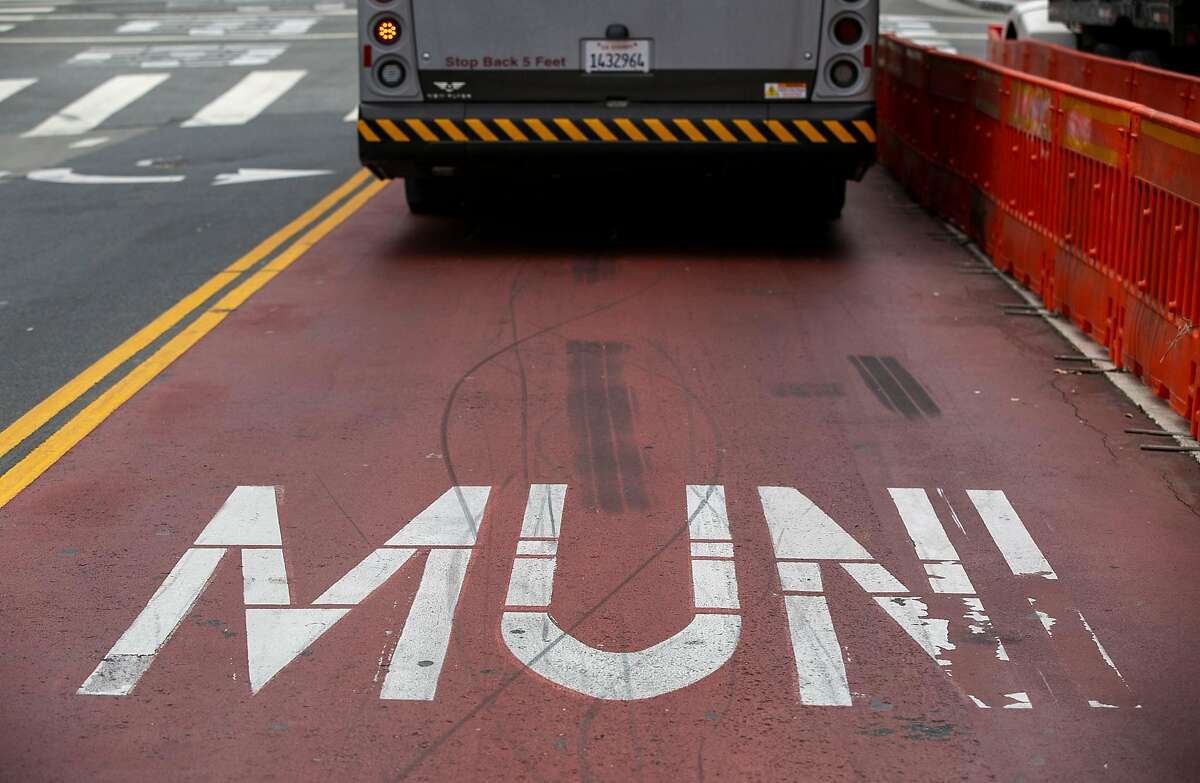 A Muni bus in the red lane transit-only lane on Haight Street near Market Street as seen Monday, July 29, 2019, in San Francisco, Calif.