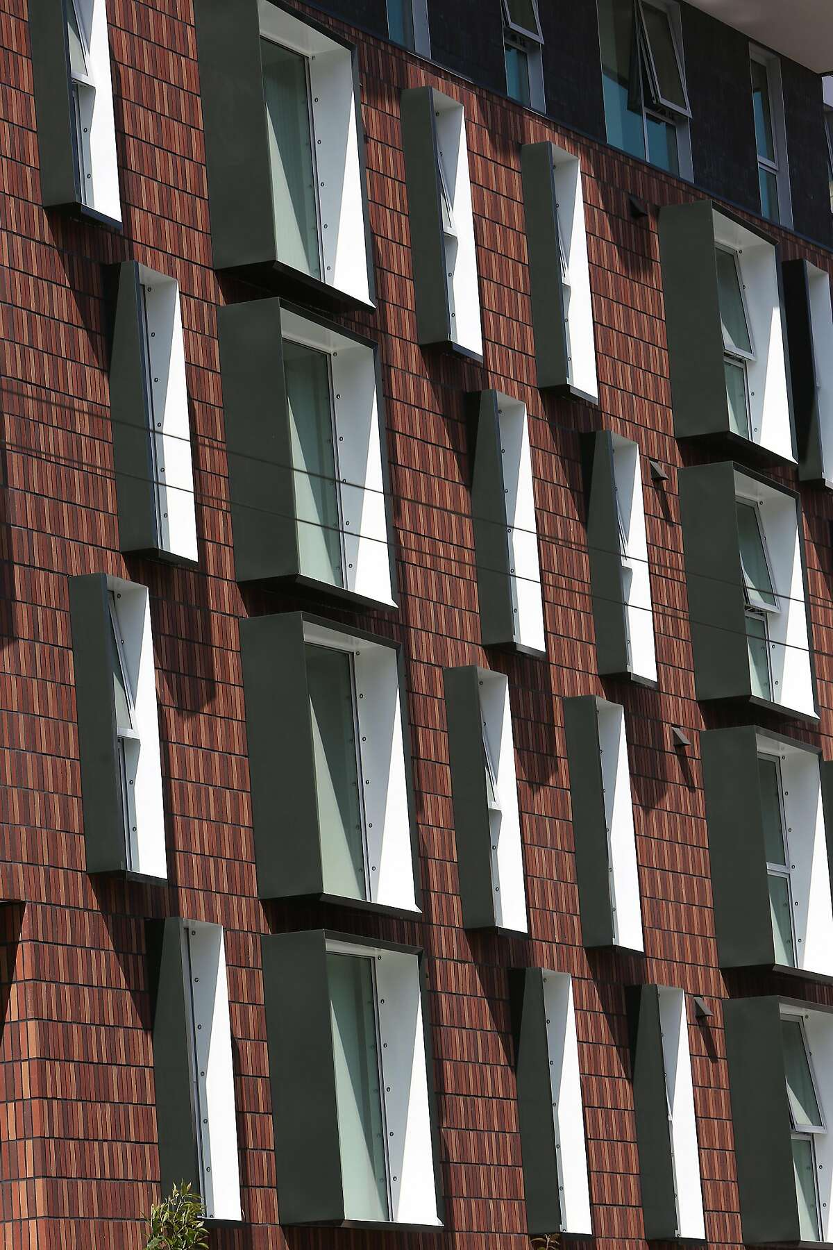 Angled window trims form a geometric pattern at 222 Taylor Street on Thursday, August 8, 2019 in San Francisco, Calif.