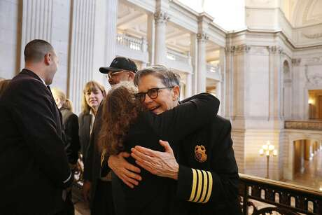 Jeanine Nicholson (right) is congratulated by Lou Fischer (second from right),  a longtime friend, at a March news conference introducing San Francisco's new fire chief. Photo: Lea Suzuki / The Chronicle
