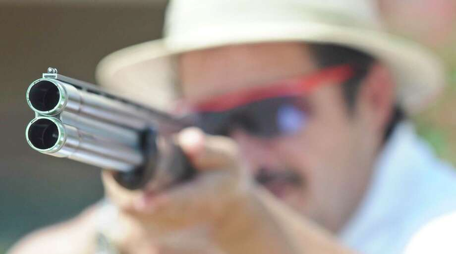Adolfo Valdez aims at the opening of the Sporting Clay Range. A reader wonders why people don't just go to the shooting range to get the satisfaction of shooting guns. Photo: Ulysses S. Romero /