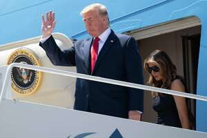 Donald and Melania Trump disembark from Air Force One upon arrival at El Paso International Airport on Wednesday as he travels to Dayton, Ohio and El Paso following mass shootings in the two cities.