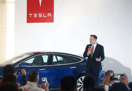 BEIJING, CHINA - OCTOBER 23: (CHINA OUT) Elon Musk, Chairman, CEO and Product Architect of Tesla Motors, addresses a press conference to declare that the Tesla Motors releases v7.0 System in China on a limited basis for its Model S, which will enable self-driving features such as Autosteer for a select group of beta testers on October 23, 2015 in Beijing, China. The v7.0 system includes Autosteer, a new Autopilot feature. While it's not absolutely self-driving and the driver still need to hold the steering wheel and be mindful of road conditions and surrounding traffic when using Autosteer. When set to the new Autosteer mode, graphics on the driver's display will show the path the Model S is following, post the current speed limit and indicate if a car is in front of the Tesla.  (VCG via Getty Images/TNS)