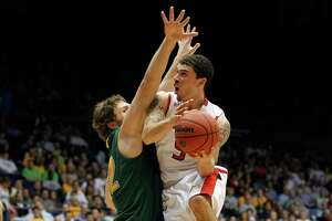 DAYTON, OH - MARCH 14:  Mike James #5 of the Lamar Cardinals drives for a shot attempt in the second half against Ben Crenca #42 of the Vermont Catamounts in the first round of the 2011 NCAA men's basketball tournament at UD Arena on March 14, 2012 in Dayton, Ohio.  (Photo by Gregory Shamus/Getty Images)