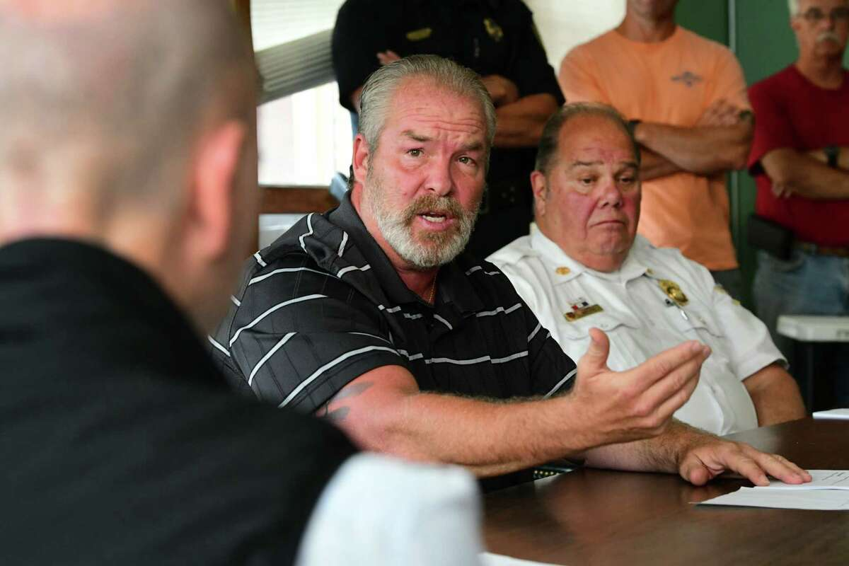 Outgoing Mayor Shawn Morse, center, tries to change civil service rules for firefighter promotions as firefighters and others pack a Civil Service Commission meeting at Cohoes City Hall on Monday, Aug. 12, 2019 in Cohoes, N.Y. Cohoes Fire Chief Joseph Fahd sits at right. (Lori Van Buren/Times Union)