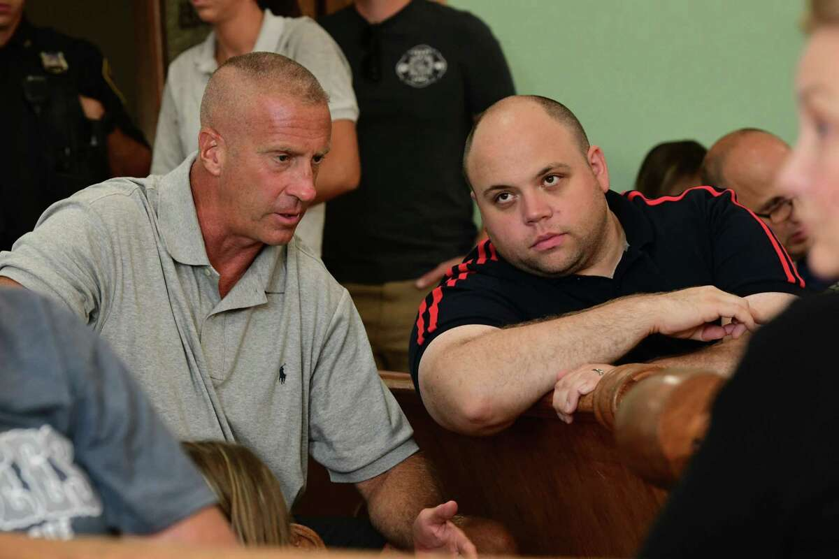 Incoming mayor William Keeler, left, talks with Cohoes Common Council member Steve Napier as outgoing Mayor Shawn Morse tries to change civil service rules for firefighter promotions during a Civil Service Commission meeting at Cohoes City Hall on Monday, Aug. 12, 2019 in Cohoes, N.Y. Napier was also a candidate for the Cohoes mayor position this last election. (Lori Van Buren/Times Union)